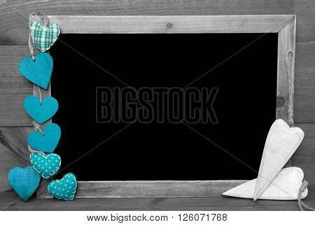 Chalkboard With Copy Space For Advertisement. Many Turquoise Hearts. Wooden Background With Vintage, Rustic Or Retro Style. Black And White Image With Colored Hot Spots. ** Note: Soft Focus at 100%, best at smaller sizes