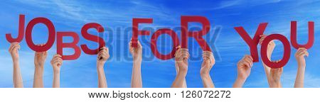 Many Caucasian People And Hands Holding Red Letters Or Characters Building The English Word Jobs For You On Blue Sky