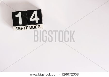 September 14th. Image of september 14 wooden office calendar on white background. Autumn day. Empty space for text.