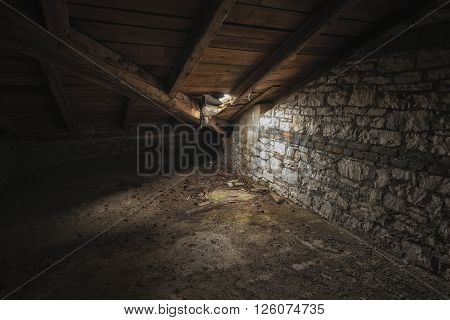 Abandoned and desolate interior of an attic