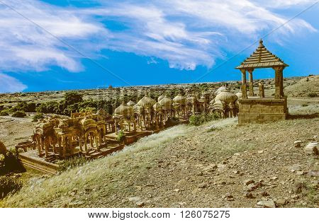 JAISALMER, INDIA - JUNE 3, 1992: Bada Bagh garden complex about 6 km north of Jaisalmer in the state of Rajasthan in India. It contains a set of royal cenotaphs.