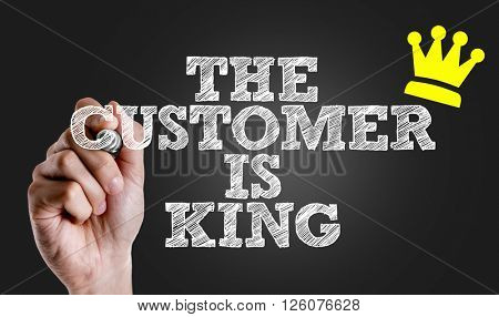 Hand writing the text: The Customer is King