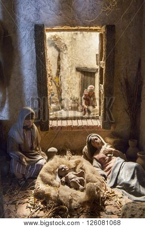 Badajoz Spain - January 4 2013: Holy Family resting after Birth of Jesus. Diorama built by Local Association of Friends of Cribs Badajoz 2013