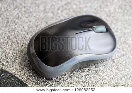 Black and grey computer mouse on a gray mouse pad