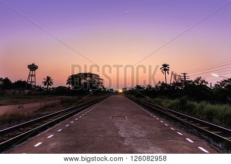Train moving to the station in sunset, Thailand