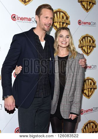 LOS ANGELES - APR 12:  Alexander Skarsgard & Margot Robbie. arrives to CinemaCon 2016: Warner Bros.