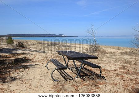 A picnic table on the Good Harbor Beach in Sleeping Bear Dunes National Lakeshore, Michigan.