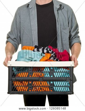 Man holding box with clothing donations over white background