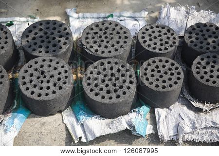 black round shape briquette coal on the street in vietnam