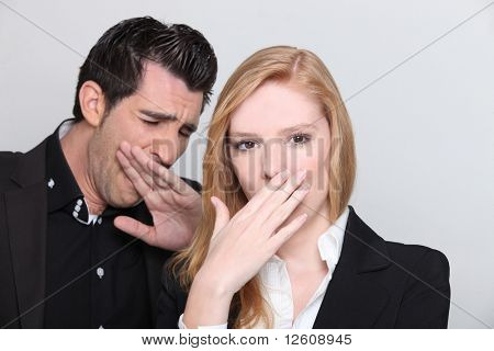 Man and woman yawning