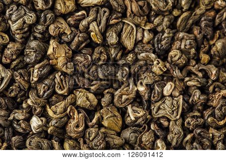 green tea leaves gunpowder background