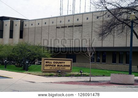JOLIET, ILLINOIS / UNITED STATES - APRIL 12, 2015:  The Will County Office Building houses government departments in downtown Joliet.