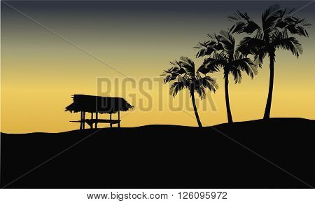 Silhouette of gazebo in hills at the sunrise