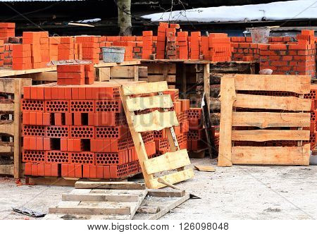 Construction materials and tools for laying a red brick wall