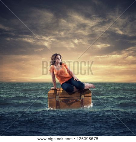 Teenager sitting on a treasure trove in the ocean