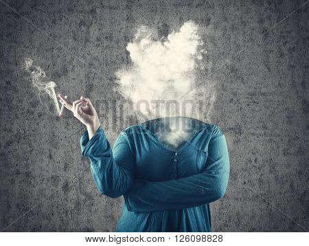 Girl smoking cigarette and the smoke raises up in place of head.