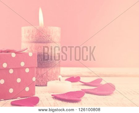 Composition With Candle, Gift Box And Hearts On White Rustic Wooden Background. Valentine's Day And