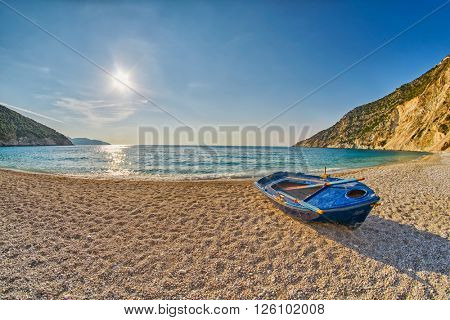 Old Abandoned Fishermen Boat at Empty Sunset Myrtos Beach in Kefalonia, Greece