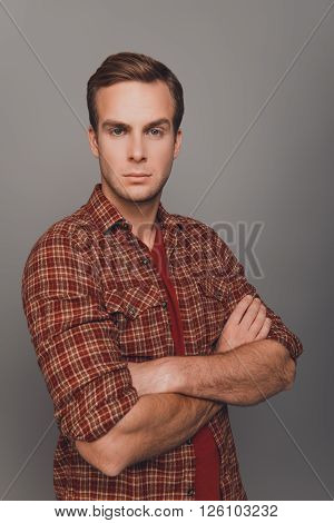 Portrait Of Strict Handsome Man Posing With Crossed Hands