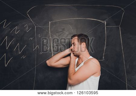 Young Man Against The Background Of Chalkboard Sleeping And Snoring