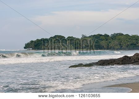 Waves breaking in Cocles beach in Manzanillo Costa Rica