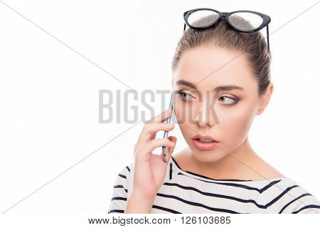 Close Up Photo Of Cute Girl Talking On  Phone With Glasses On Head