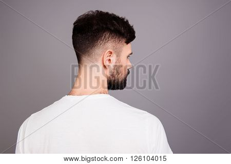 Close Up Portrait Of Man's Back Isolated On Gray Background