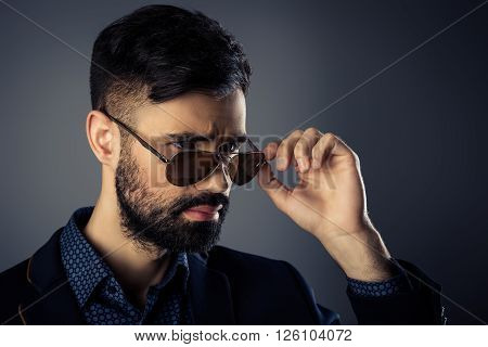 Portrait Of Brutal Trendy Man In Jacket And Spectacles