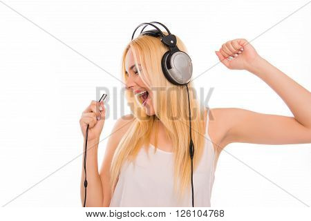 Cheerful Lady With Mp3 And Headphones Listening Music And Singing