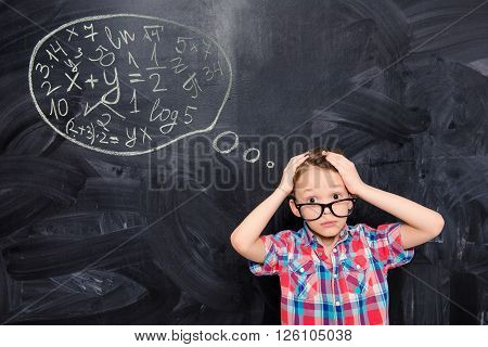 Portrait Of Young Schoolboy In Glasses  With Confused Expression Of His Face