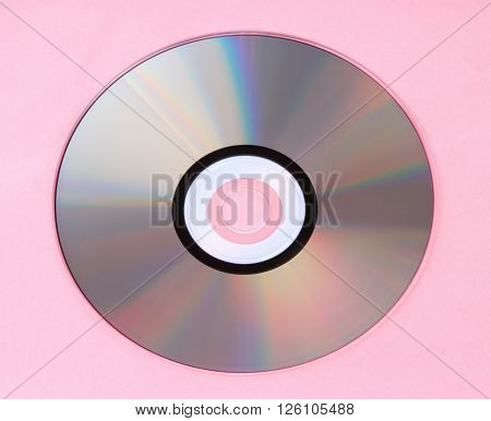 image of one compact disc on pink background