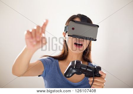 Girl play game with vr and joystick