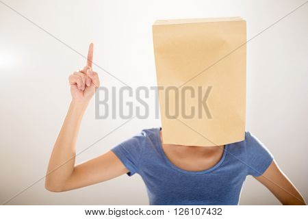 Woman with bag covering her head and finger point up