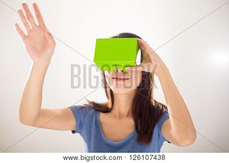 Asian woman using virtual reality device