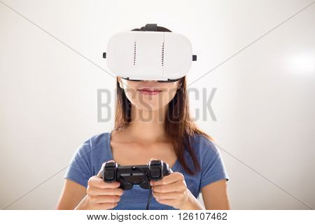 Girl play video game with wearing VR device