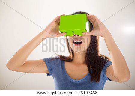 Excited Woman using virtual reality