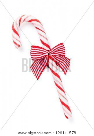 Candy cane with bow. Isolated on white background