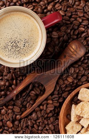 Coffee cup, beans and brown sugar. Top view