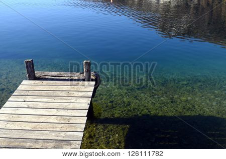 Wooden Pontoon And Blue Water