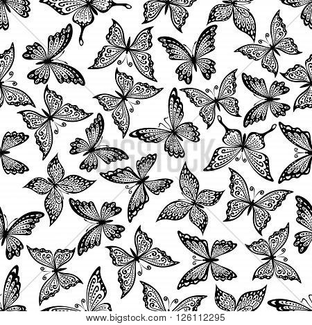 Black and white vintage seamless flying butterflies pattern with decorative wings, adorned by delicate curly ornaments. Great for nature background, elegant fabric print or interior design