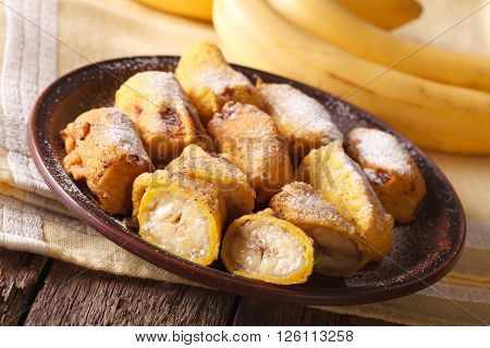 Tasty Fried Bananas In Batter With Powdered Sugar. Horizontal