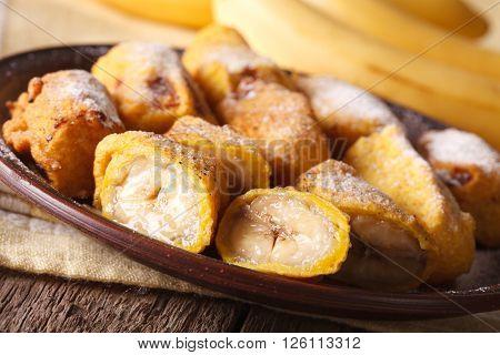 Fried Bananas Sprinkled With Powdered Sugar Close-up. Horizontal