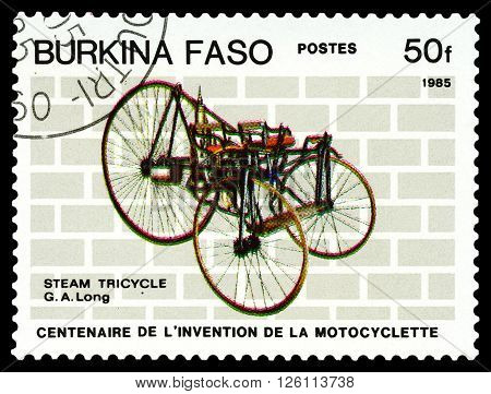 STAVROPOL RUSSIA - MARCH 16 2016: a stamp printed in Burkina Faso shows Steam Tricikle G. A. Long stamp devoted to the centenary of the invention of motorcycle circa 1985