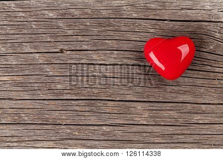 Candy heart over wood. Valentines day background. Top view with copy space