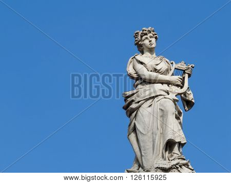 SAN JOSE, COSTA RICA - April 9: Statue depicts the Lady of Music on National Theatre of Costa Rica. April 9, 2016  in