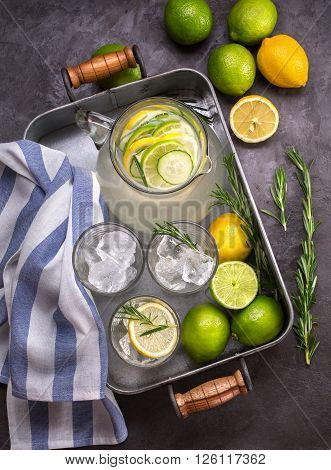 Homemade lemonade with fresh lemon lime and rosemary summer drink. Top view