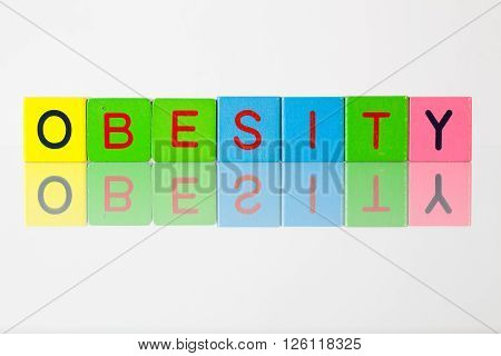Obesity - an inscription from children's wooden blocks