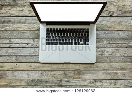 Modern designed laptop on old wooden desk