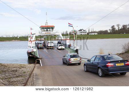 Wijk bij Duurstede, Netherlands, 11 april 2016: cars enter ferryboat on river rhine at Wijk bij Duurstede in the netherlands