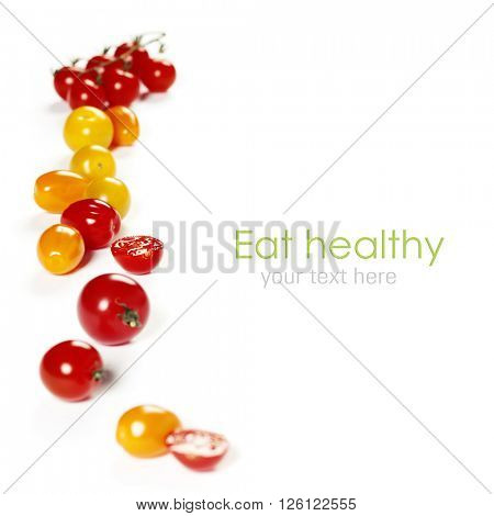colorful tomatoes over white background